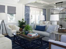 roman shade family room gray couch beachfront curtains