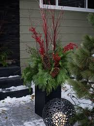 Outside Home Christmas Decorating Ideas Best 25 Outdoor Christmas Planters Ideas On Pinterest Christmas
