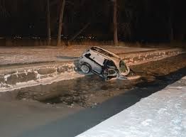 liverpool woman found dead under ice after crashing suv into creek