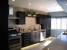 amazing interesting kitchen decorating ideas for interior home design appealing glass tile backsplash kitchen decorating ideas with dark finish cherry wood kitchen cabinet with brushed
