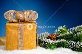 gift box and christmas tree branch in snow on blue background