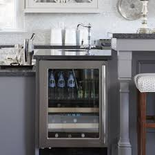 55 great ideas for kitchen islands the popular home entertain guests by turning your kitchen island into a home bar transform your island with swivel bar stools built in wine fridges or wine bottle holders