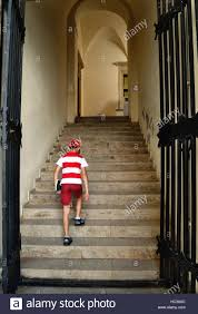Stairs Book by Boy In Red And White T Shirt Climbing Stairs Of The Old
