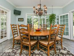traditional dining room with french doors u0026 chandelier in monkton