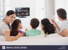 Tv In Living Room Family Watching Tv In Living Room Stock Photo Royalty Free Image