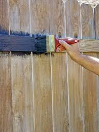 How To Paint Over Wood Paneling by Fence Painting And Staining Guide Quick Tips Hgtv