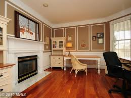 traditional home office with wainscoting u0026 stone fireplace in