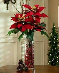 exploding with color and festive charm this poinsettia silk plant