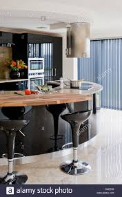 modern kitchen extractor fans pair of black bombo bar stools at black breakfast bar in modern