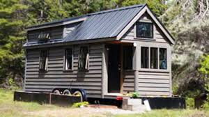 woman u0027s triple axle tumbleweed tiny house charming small house