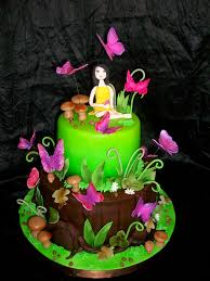 really like the forest feel of this butterfly garden cake i think