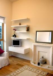 interior non working fireplace beside narrow white corner
