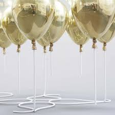 gold balloons gold balloons and glass top coffee table the up coffee table by