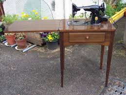 Singer Sewing Machine Cabinets by Singer Sewing Machine In Cabinet Table Electric Vintage Laptop