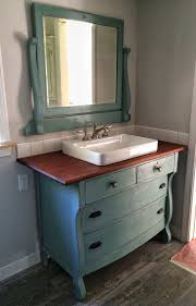 i just repurposed an old dresser to use as a vanity in our new