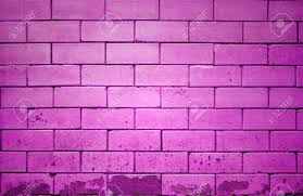 pink brick wall getting older from the bottom stock photo picture