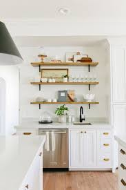 Kitchen Cabinet Shelf Hardware by Gorgeous All White Kitchen With Brass Hardware Marble Counters