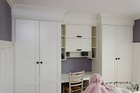 for the girls bedroom we created a bination wardrobe study area