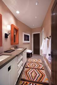 narrow bathroom with neutral wall colors and aztec runner