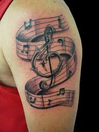 cross tattoos on bicep music notes and cross tattoos photos pictures and sketches