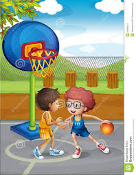 two boys playing basketball at the basketball court stock images