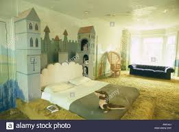 trompe loeil castle bed in seventies bedroom with lime green
