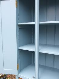 freestanding larder cupboard with two baskets