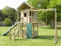 kids garden ideas with small wood house for a comfortable
