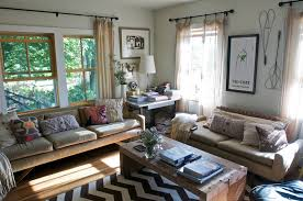 aztec rug living room rustic with black and white eames ottoman