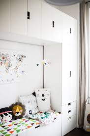 couch and storage organization in the nursery with the help of