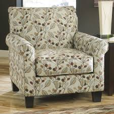 accent chair in leaf print fabric by benchcraft wolf and