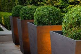 outdoor and patio four bronze tall outdoor planters on wooden