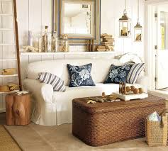 country white coastal living room theme with brown wicker coffee