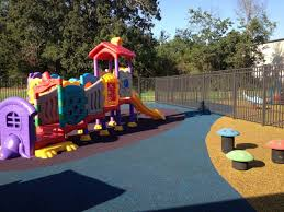 outdoor a playground with a slide colorful then a fence and