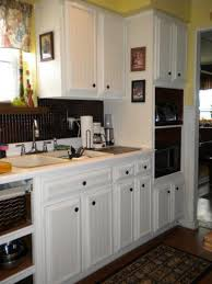removable wallpaper for kitchen cabinets kitchen cabinet update using bead board wallpaper by martha stewart