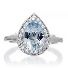 aquamarine diamond ring ring 10x7 pear cut diamond halo engagement ring