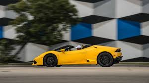yellow and black lamborghini 2016 lamborghini huracan lp 610 4 spyder convertible review with
