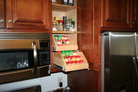 amazing upper cabinet storage solutions with wooden pull out spice