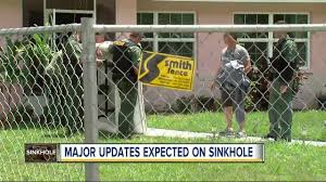 sinkhole swallows two homes in land o u0027 lakes neighborhood cleanup