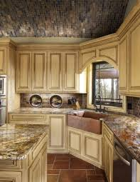 tuscan kitchen with glazed cabinets and copper corner sink ideas