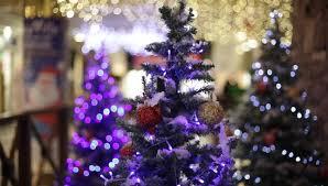 White Christmas Tree Decorations Ireland by Festive Christmas Tree In The Spotlight And White Smoke Stock
