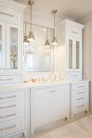 All White Bathroom Features An Extra Wide Single Vanity Topped - White cabinets bathroom design