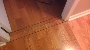 previous owner did an awful job installing laminate flooring