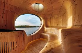 curved wood wall grotto sauna with a curved wood interior by partisans homeli