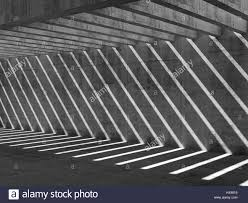 a pattern of shadow and light abstract empty concrete interior background corridor with ceiling
