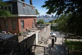 the first to leave east boston are us rising rents are pushing a view of the waterfront from the walkway between ruth and marginal streets in the fast