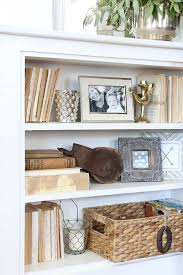 how to style a bookcase a stroll thru life how to style bookcases tips ideas