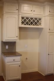 wine rack cabinet over refrigerator built in wine rack above fridge still on the fence about this one