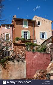 clay adobe style homes in roussillon france stock photo royalty