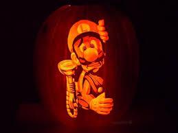Best Halloween Pumpkin Carvings - random luigi gears up for a fright in one amazing halloween